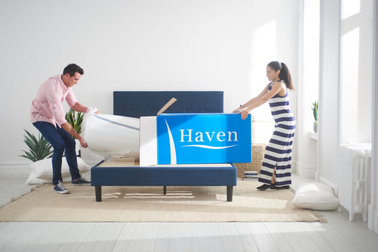 A couple Unboxing a Haven Bed Mattress